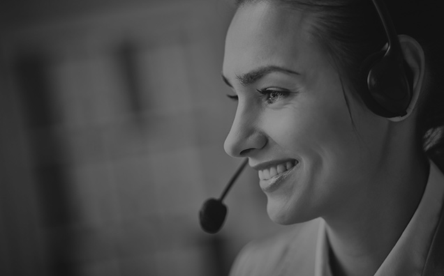 image of a lady's face smiling with a headset on